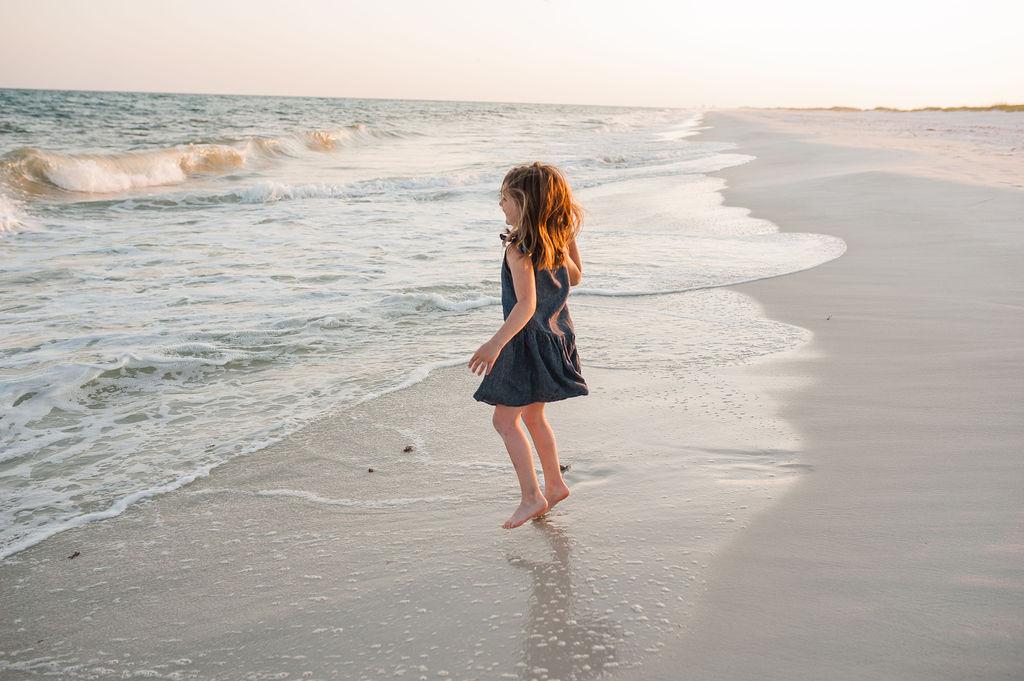 girl jumping waves-Pensacola Beach Photographer