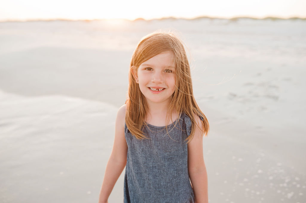 girl by dunes- Navarre Beach Photographer