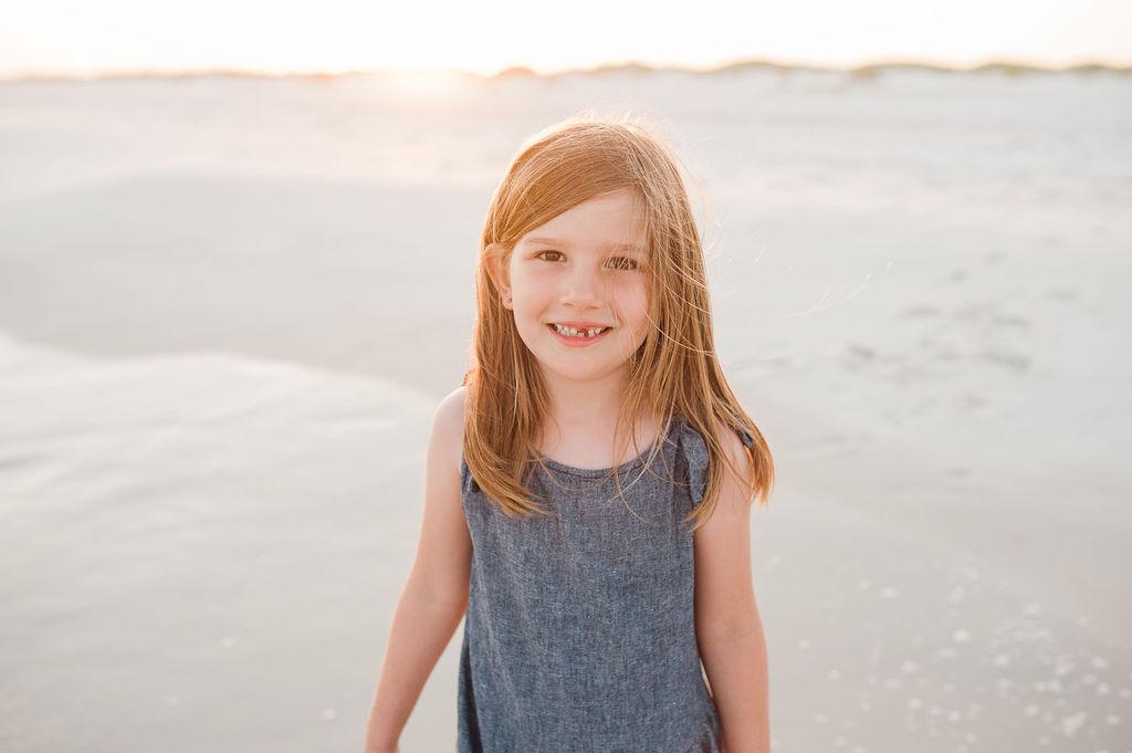 girl by dunes- Navarre Beach Photographer