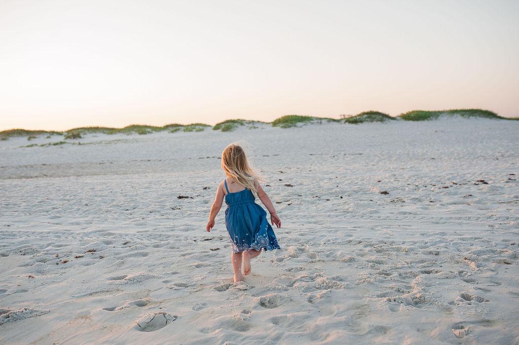 girl running on beach- Navarre Beach Photographer
