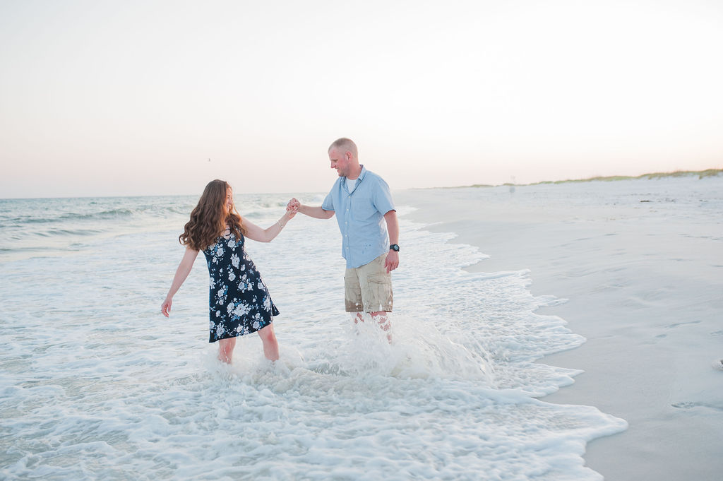 dancing in waves mom and dad-pensacola beach family photographer