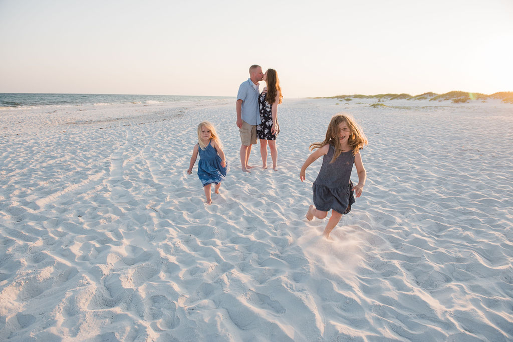 running on beach-pensacola beach family photographer