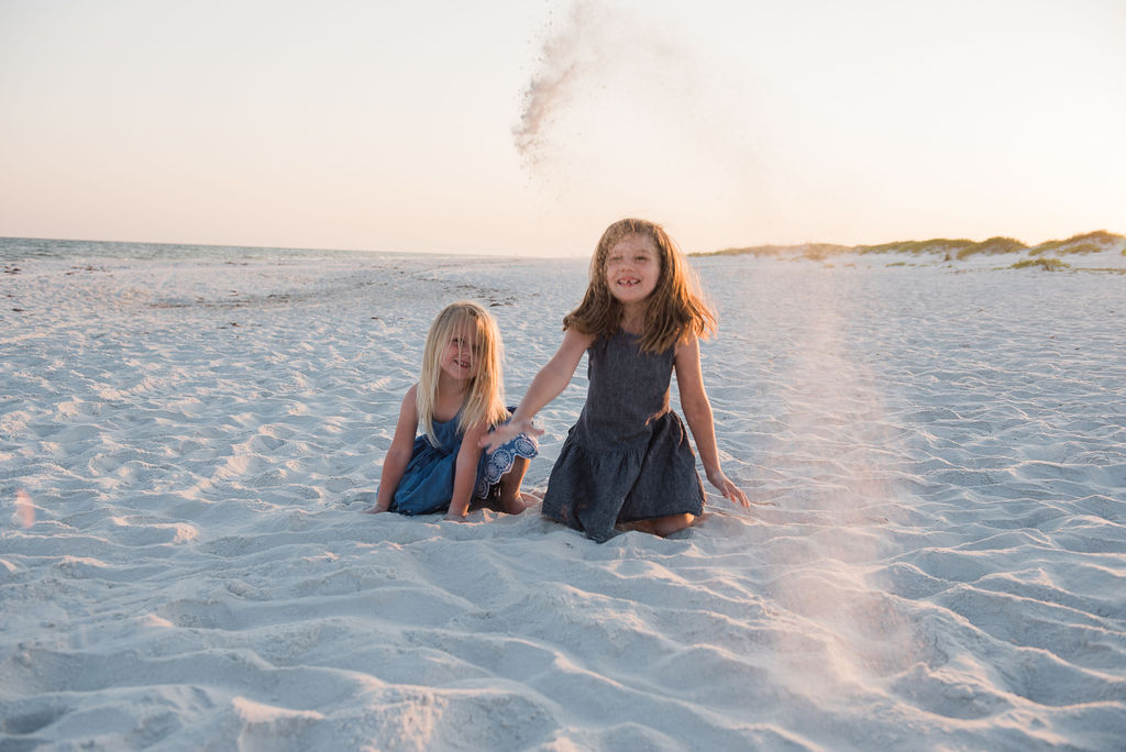 girls throwing sand-pensacola beach photographer