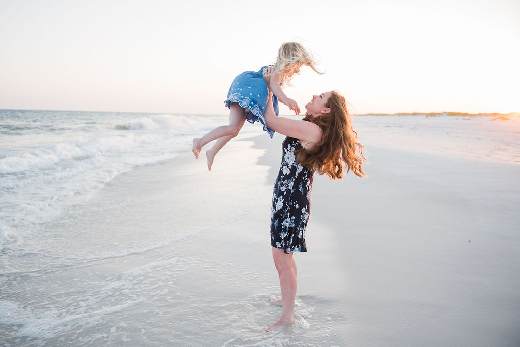 mom twirling daughter-pensacola beach family photographer