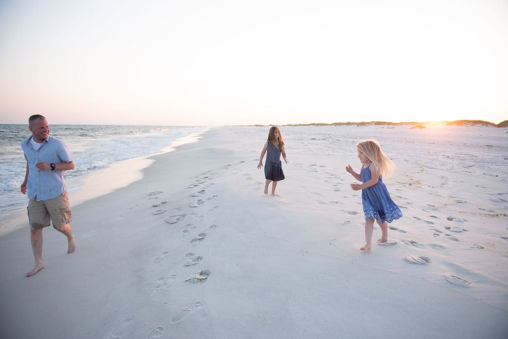 dad running with girls on beach- Navarre Beach photographer
