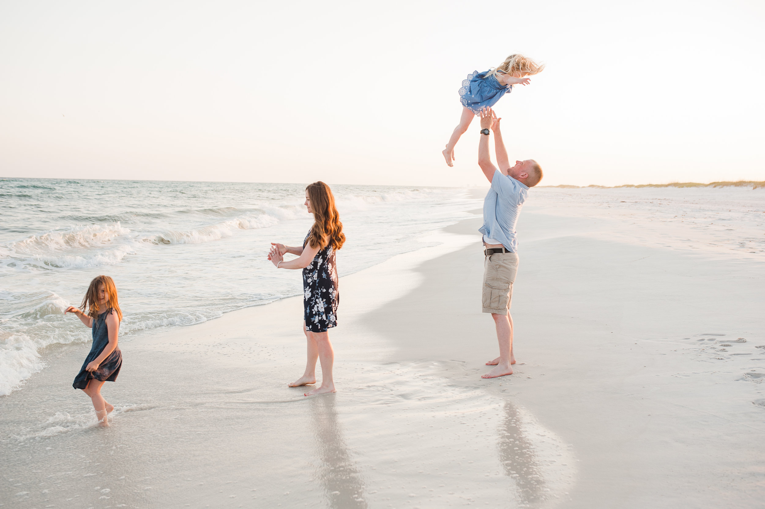 family playing by ocean-Navarre family photographer