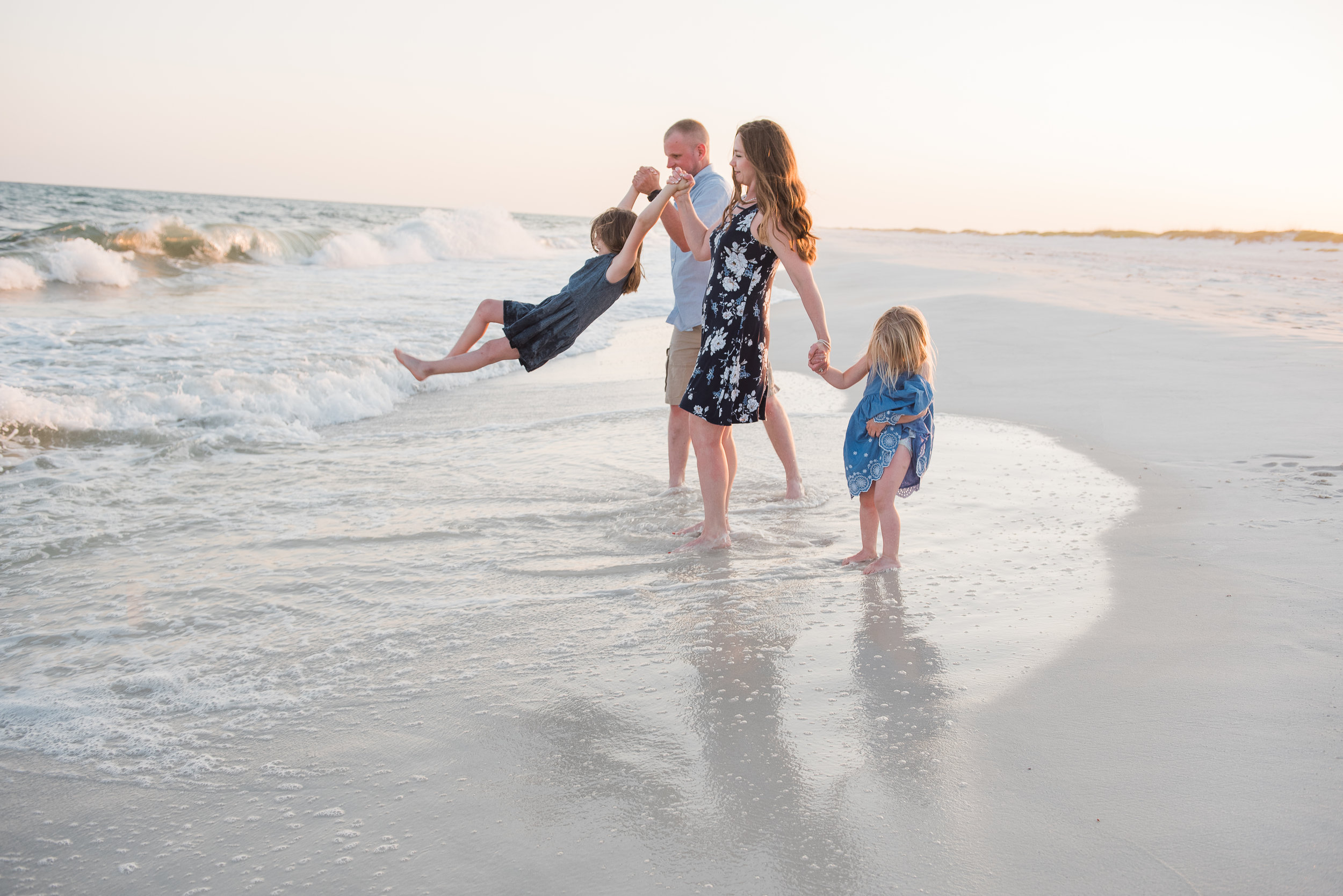 playing in ocean-pensacola beach photographer