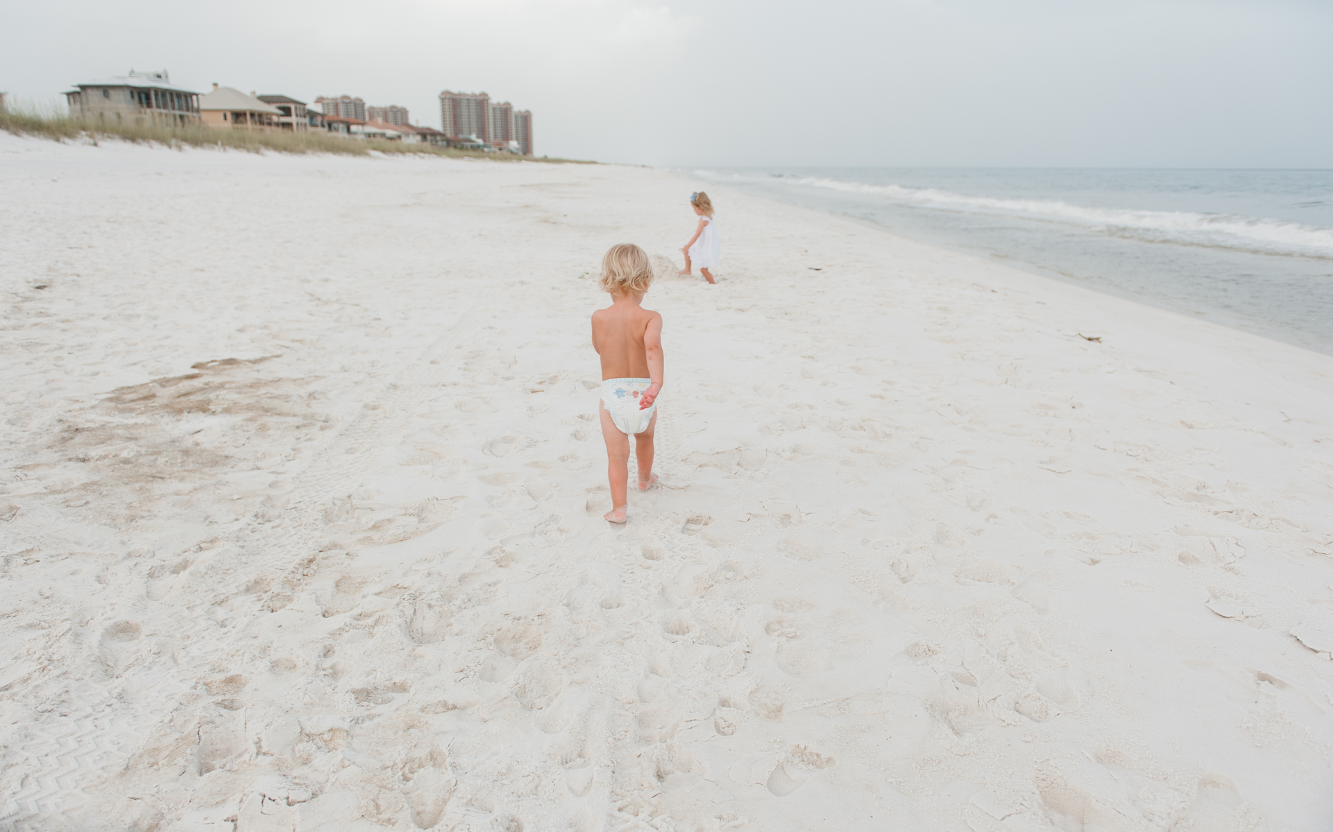 boy in sand-pensacola beach photographer