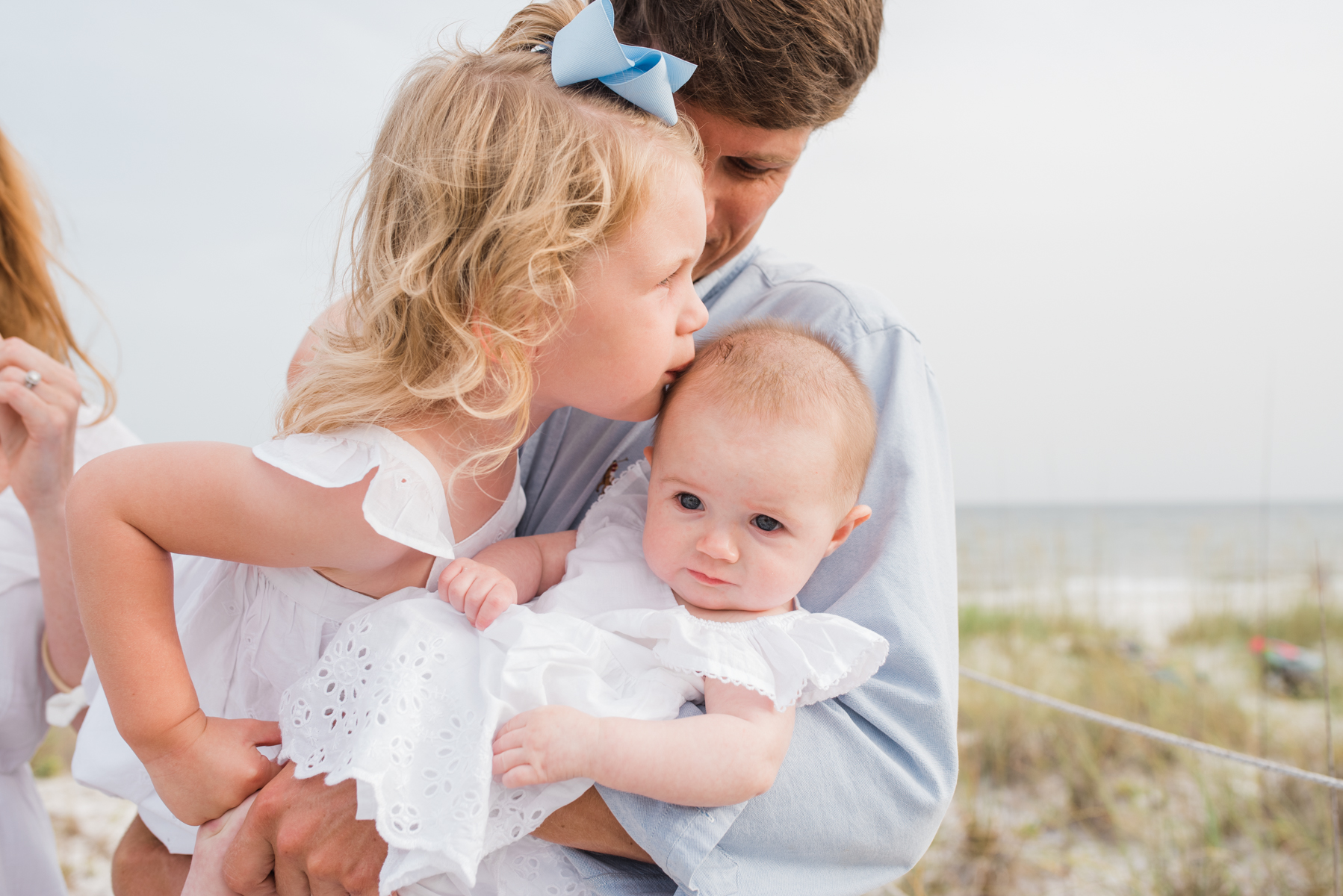 girl kissing baby-pensacola beach photographer