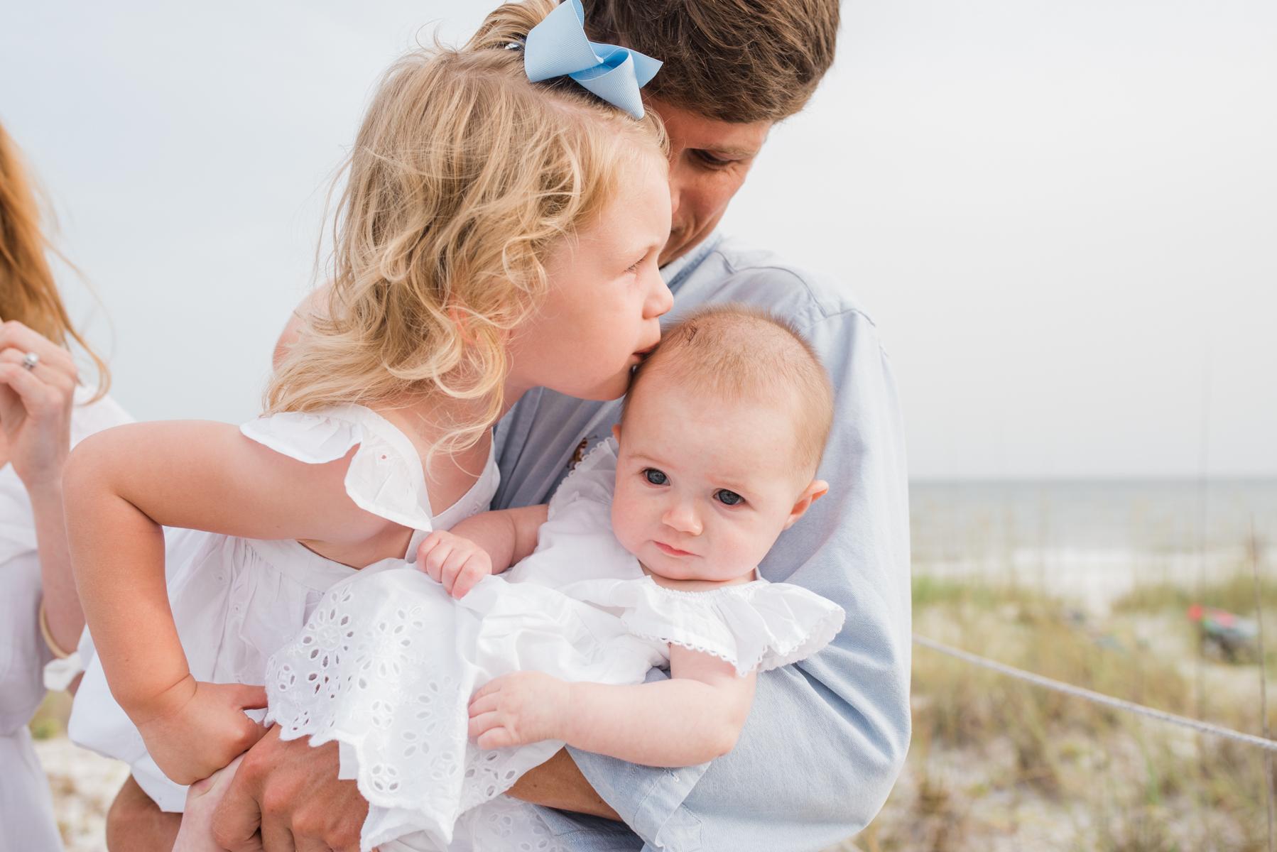 girl kissing baby-pensacola beach photographer