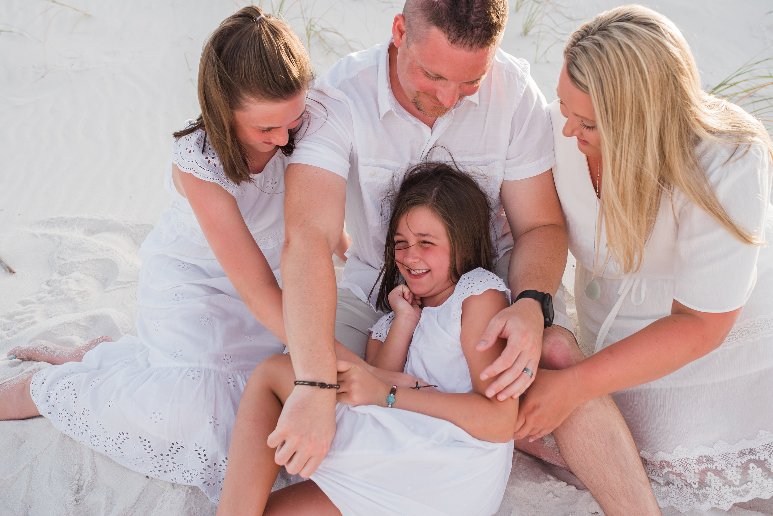 family tickling on beach-pensacola beach photographer-ann mangum photography