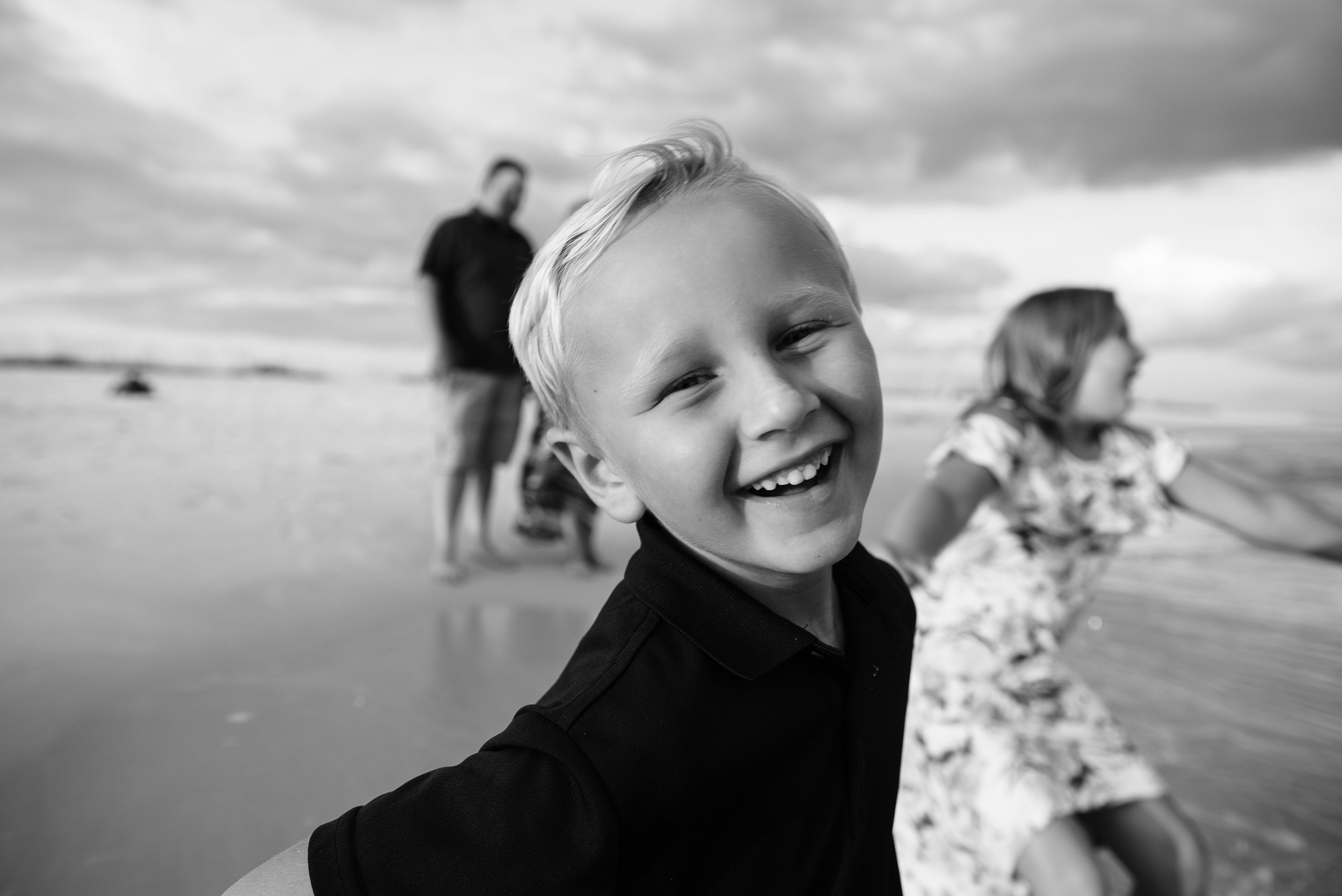 boy by ocean-pensacola beach family photographer