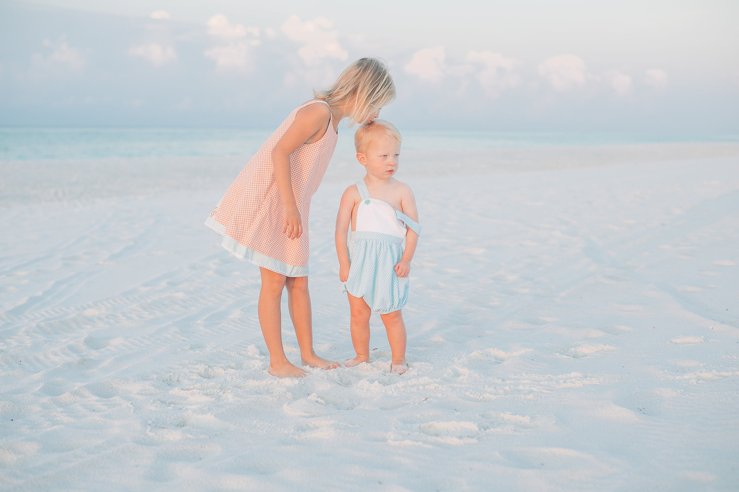 sister kissing on brother-pensacola beach family photographer