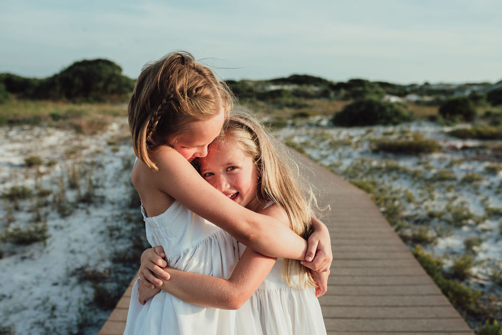 girls hugging-pensacola beach photographer