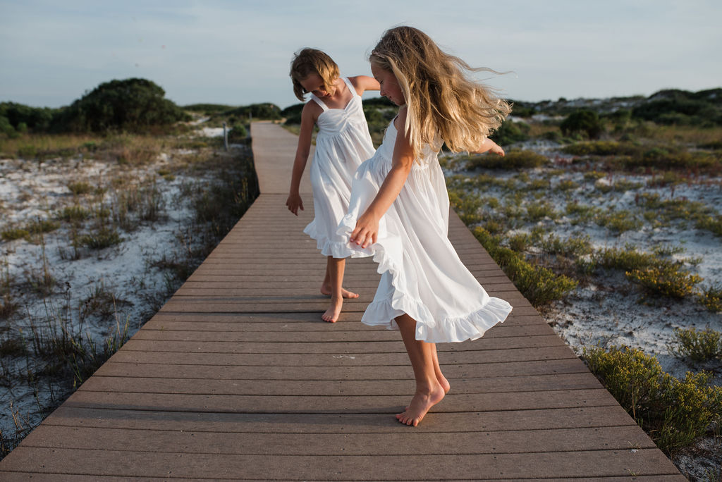 girls dancing on boardwalk-pensacola beach ann mangum photography