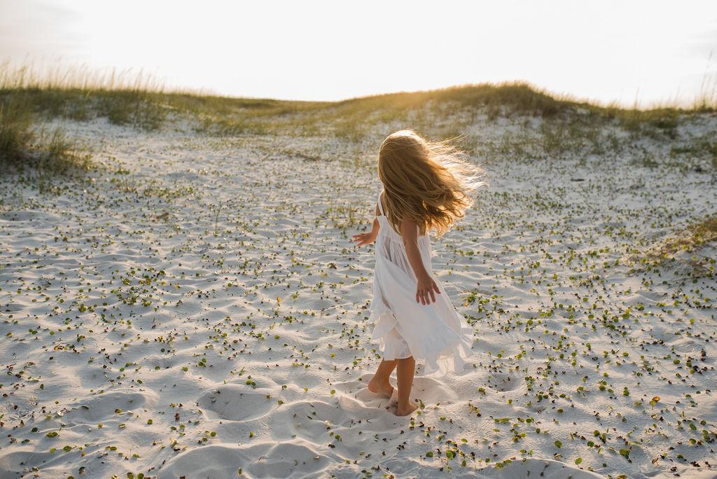 girl walking in dunes-pensacola photographer