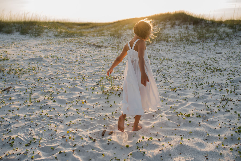 girl dancing in dunes-pensacola family photographer