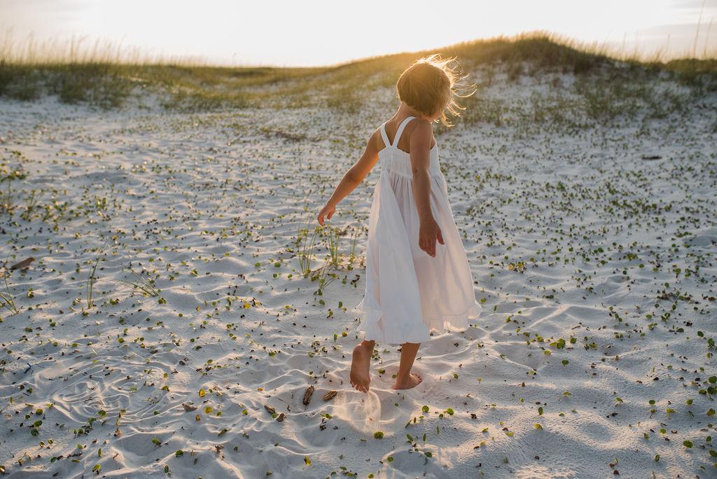 girl dancing in dunes-pensacola family photographer