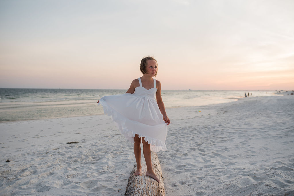 girl on log at beach-pensacola family photographer