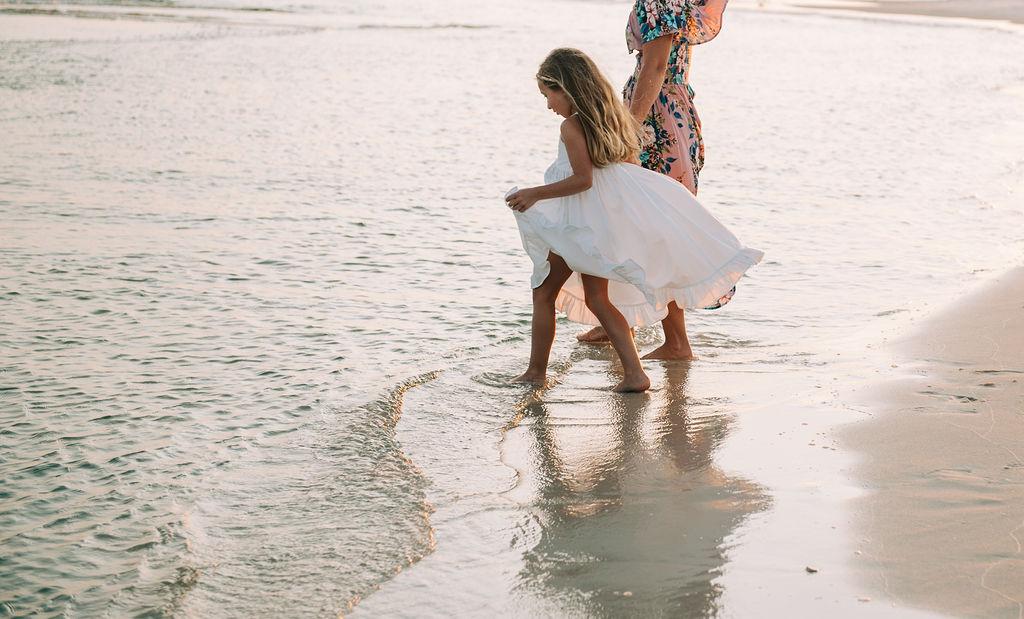 girl and mom at beach-pensacola family photographer