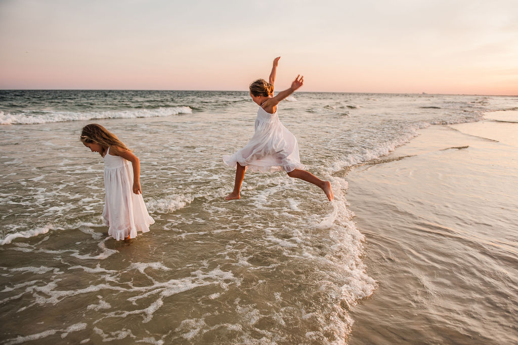 girls jumping waves-pensacola family photographer
