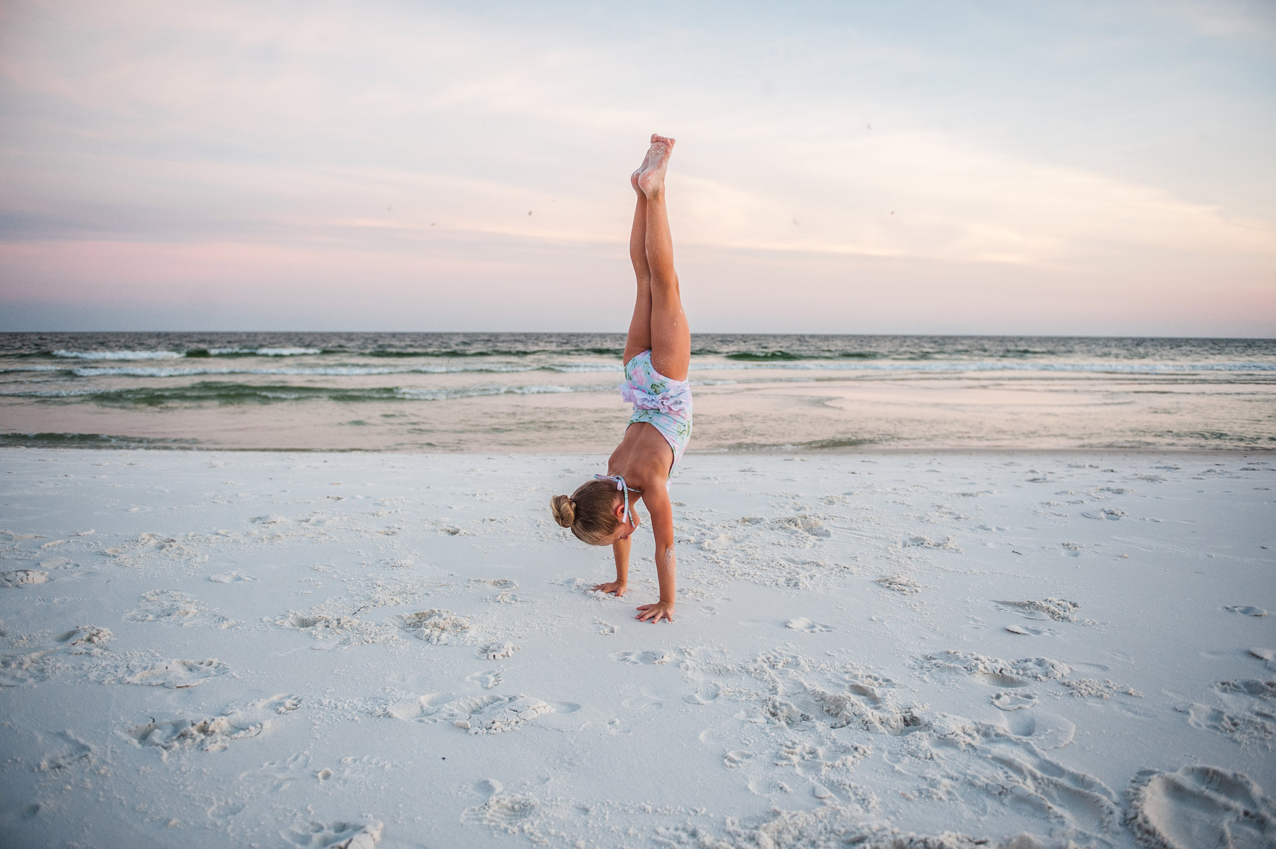 girl doing hand stand in sand-pensacola family photographer-ann mangum photography