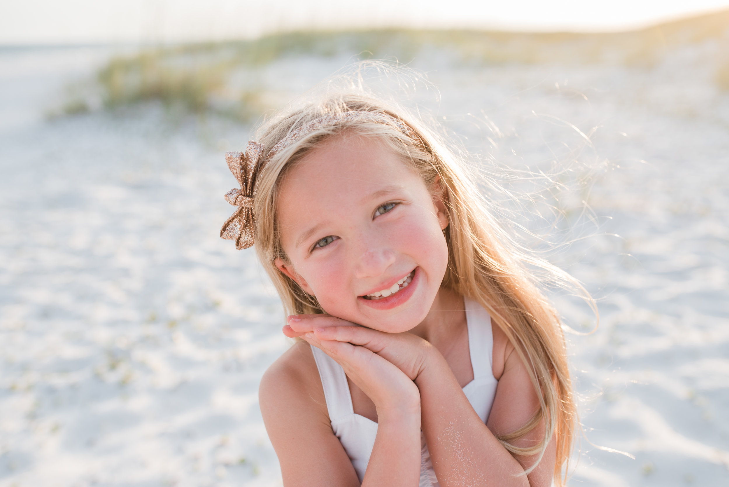 girl with hand by face-pensacola family photographer