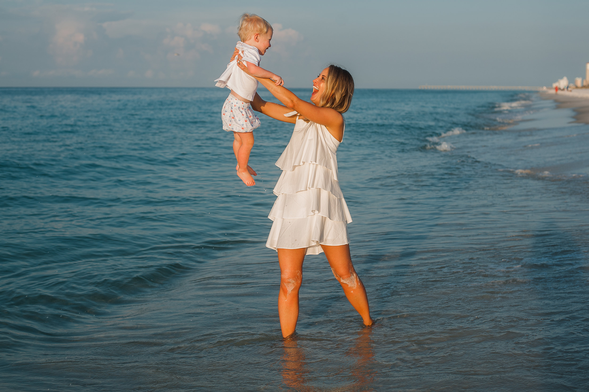 mom and baby in water-Pensacola Family Photographer-Ann Mangum Photography