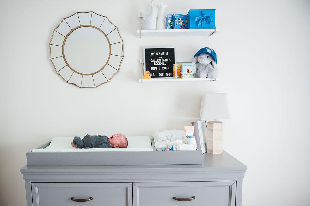 baby on table-Pensacola newborn photographer-Ann Mangum Photography
