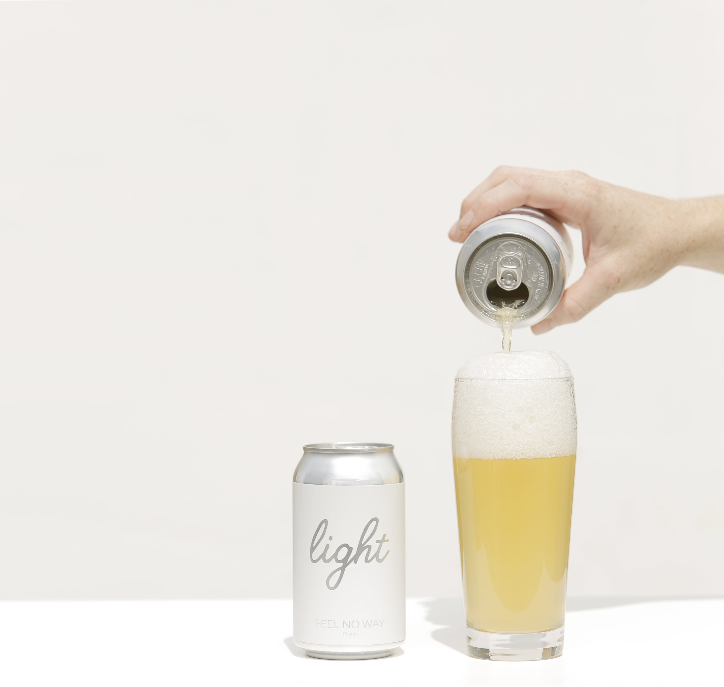 Photo of Feel No Way Light in a can and being poured into a glass