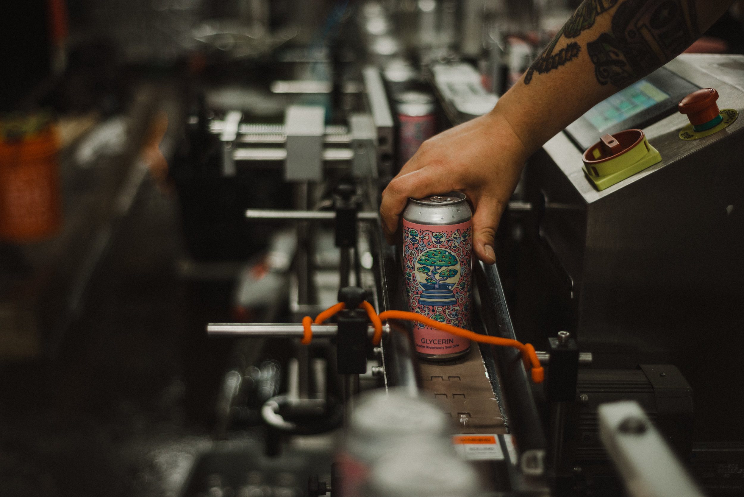 Photo of Josh taking a can of Glycerin off the canning line