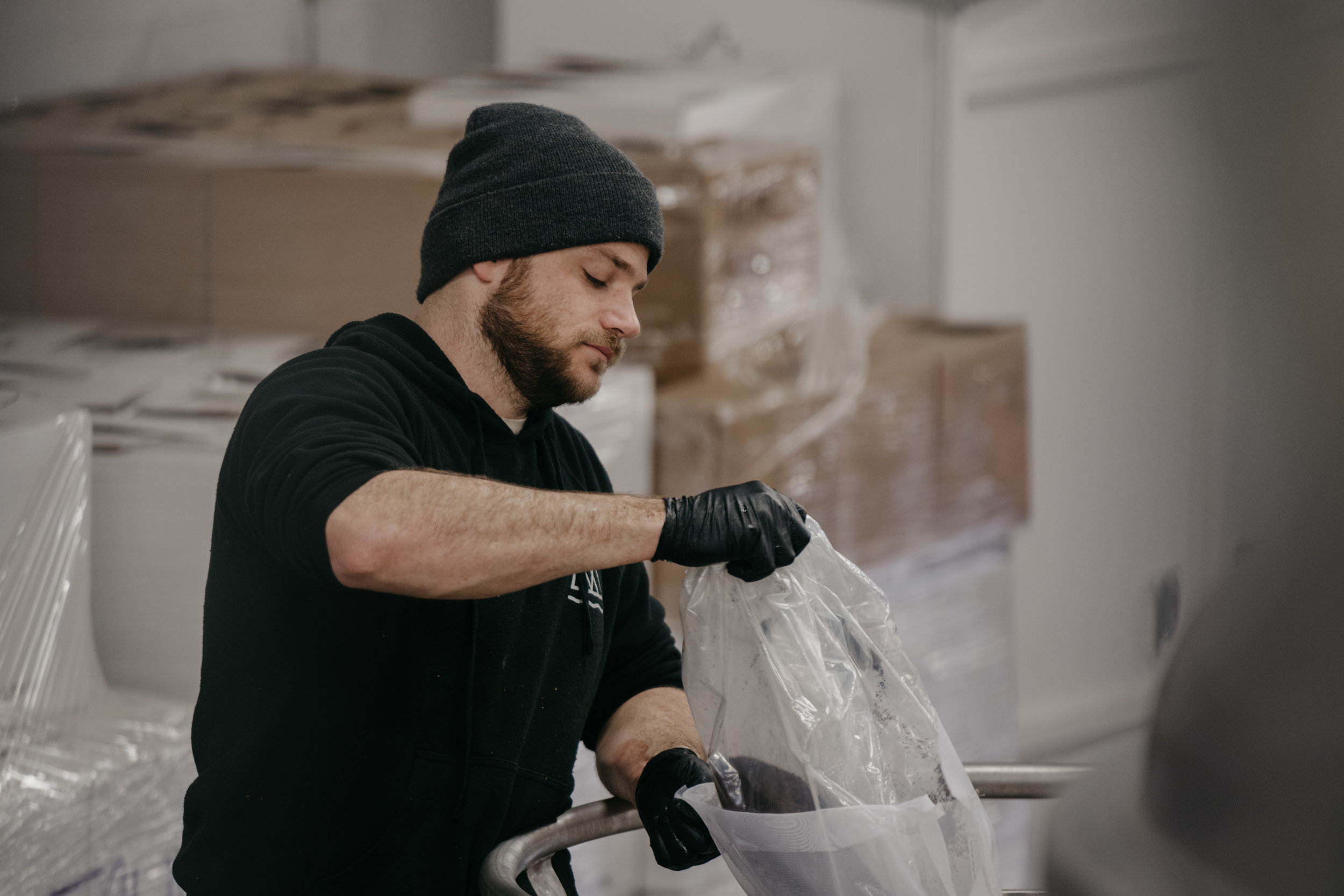 Photo of Conor adding ingredients