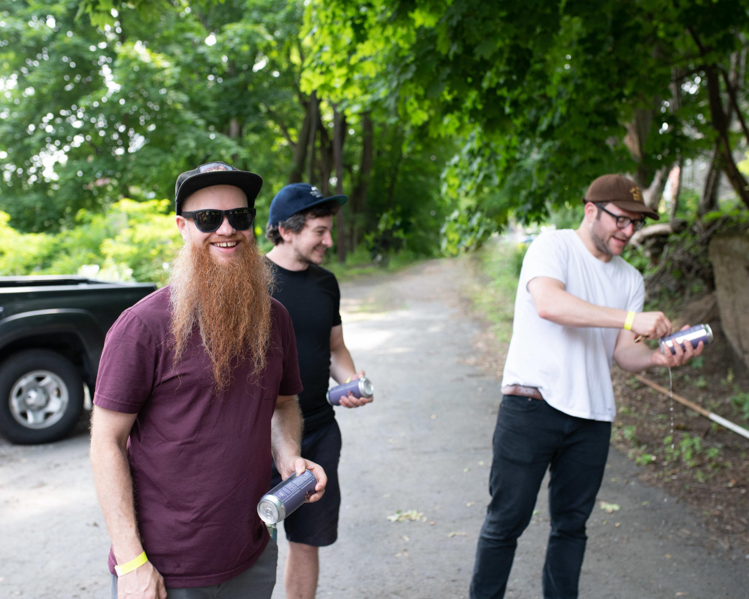 Joel, Eli, & Justin prepare their cans for a group shotgun.