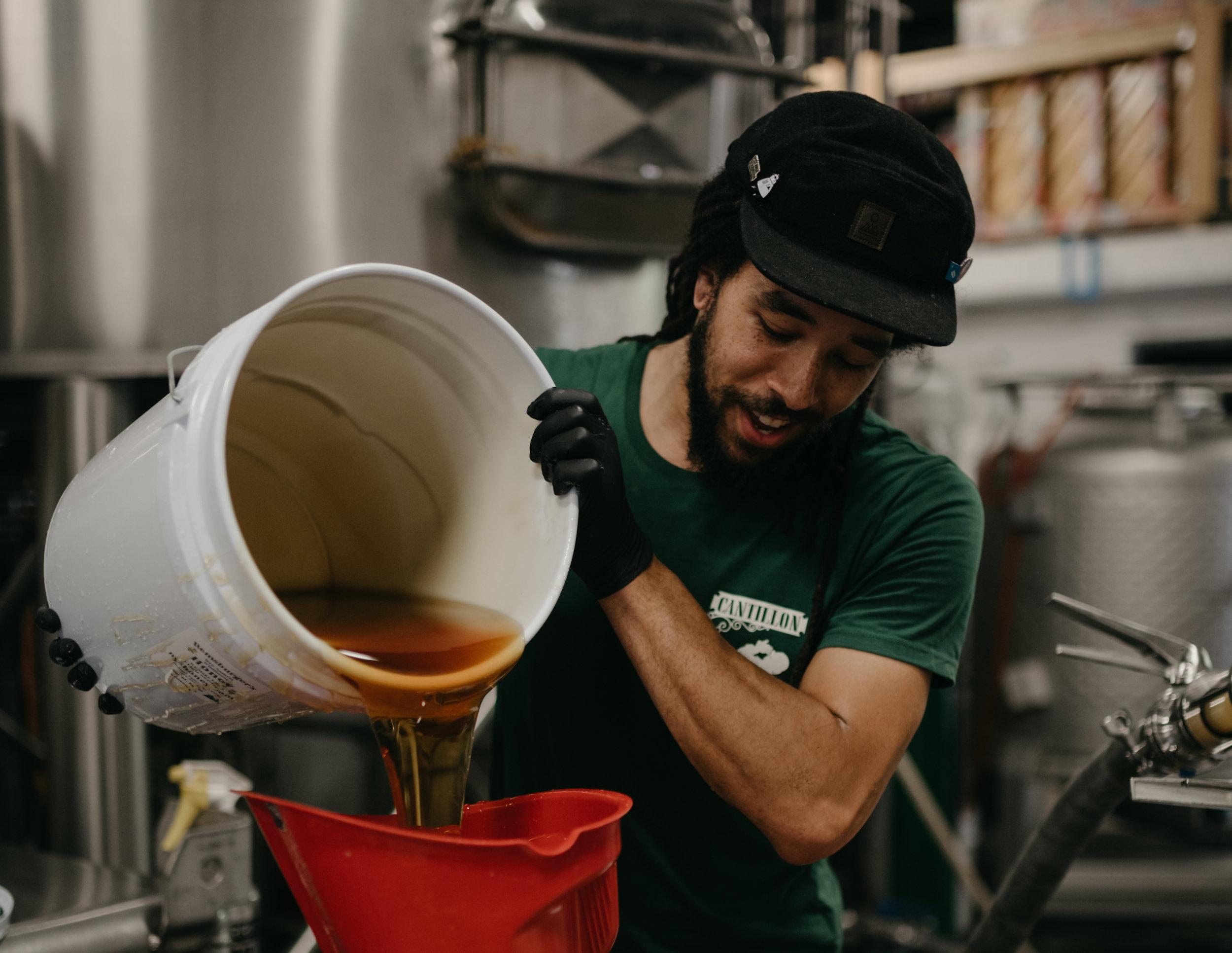 Photo of Jamal pouring honey