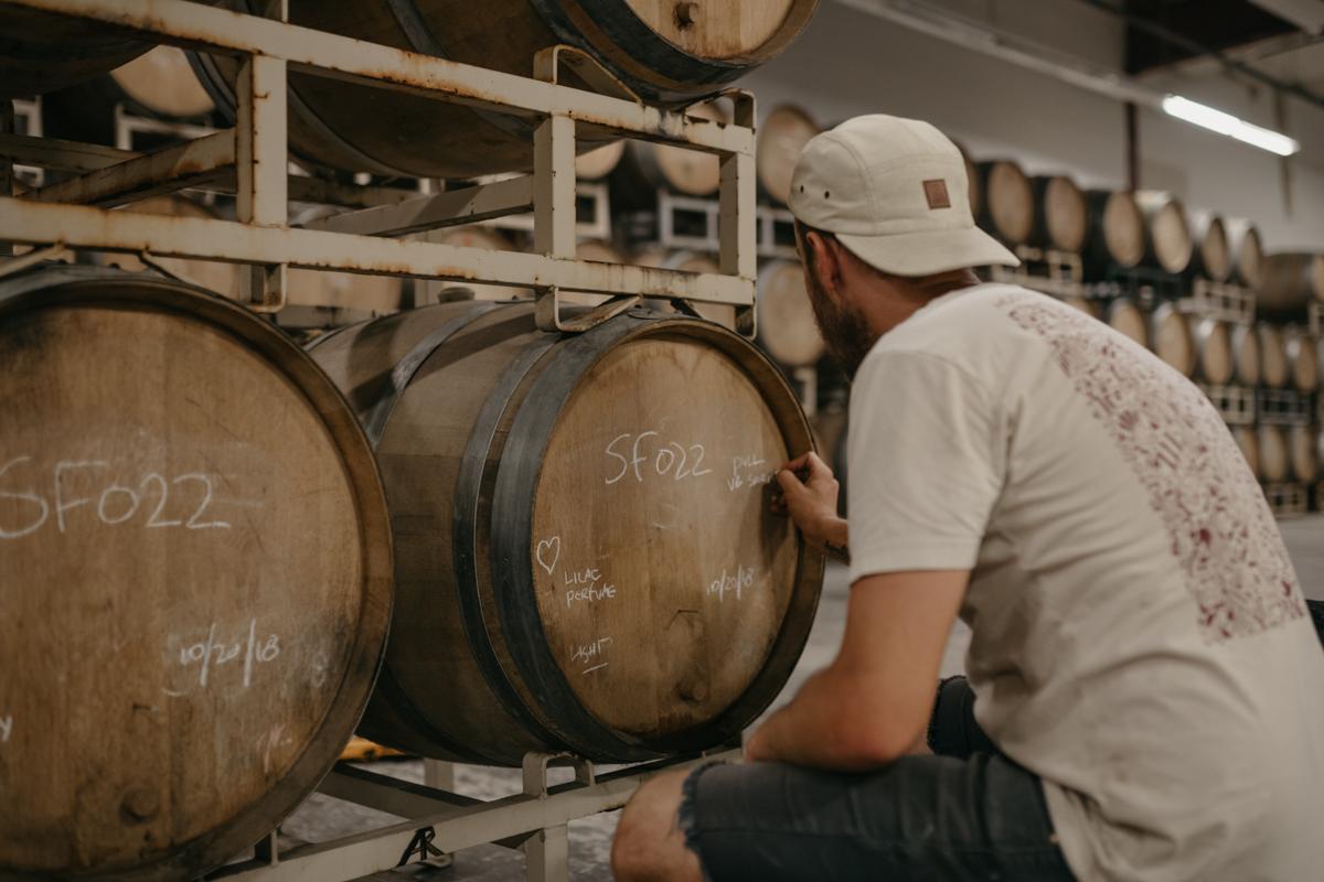 Photo of Mike labeling barrels after sampling them