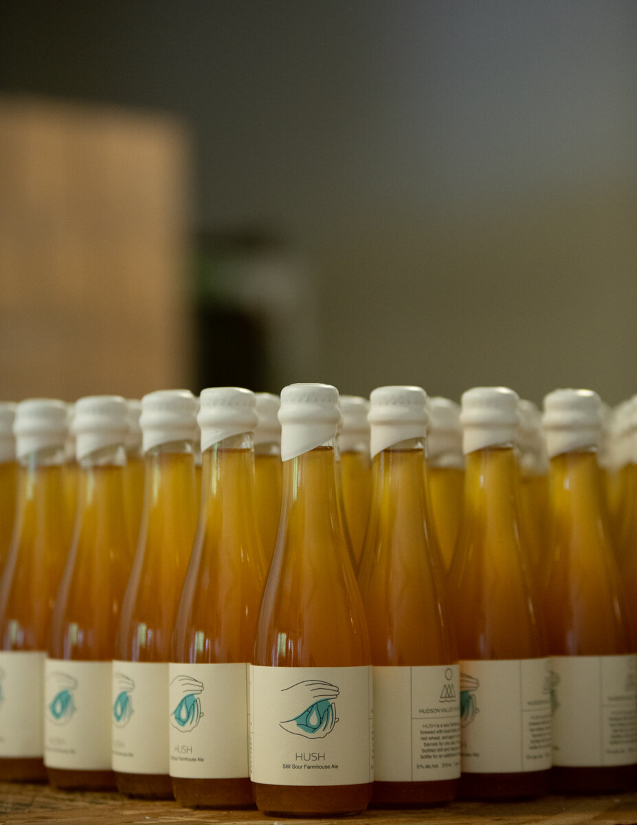 Bottles of Hush after being waxed