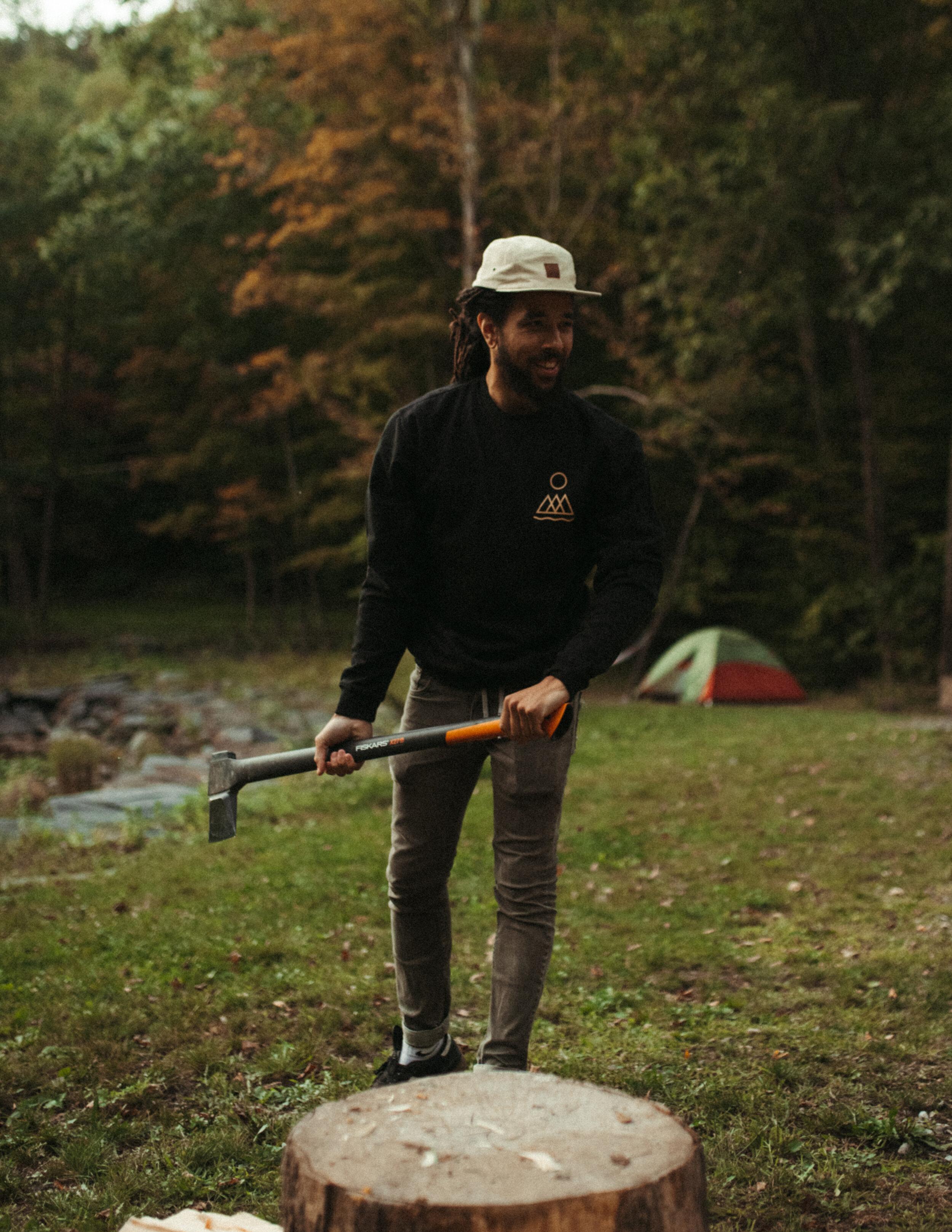 Photo of Jamal chopping wood
