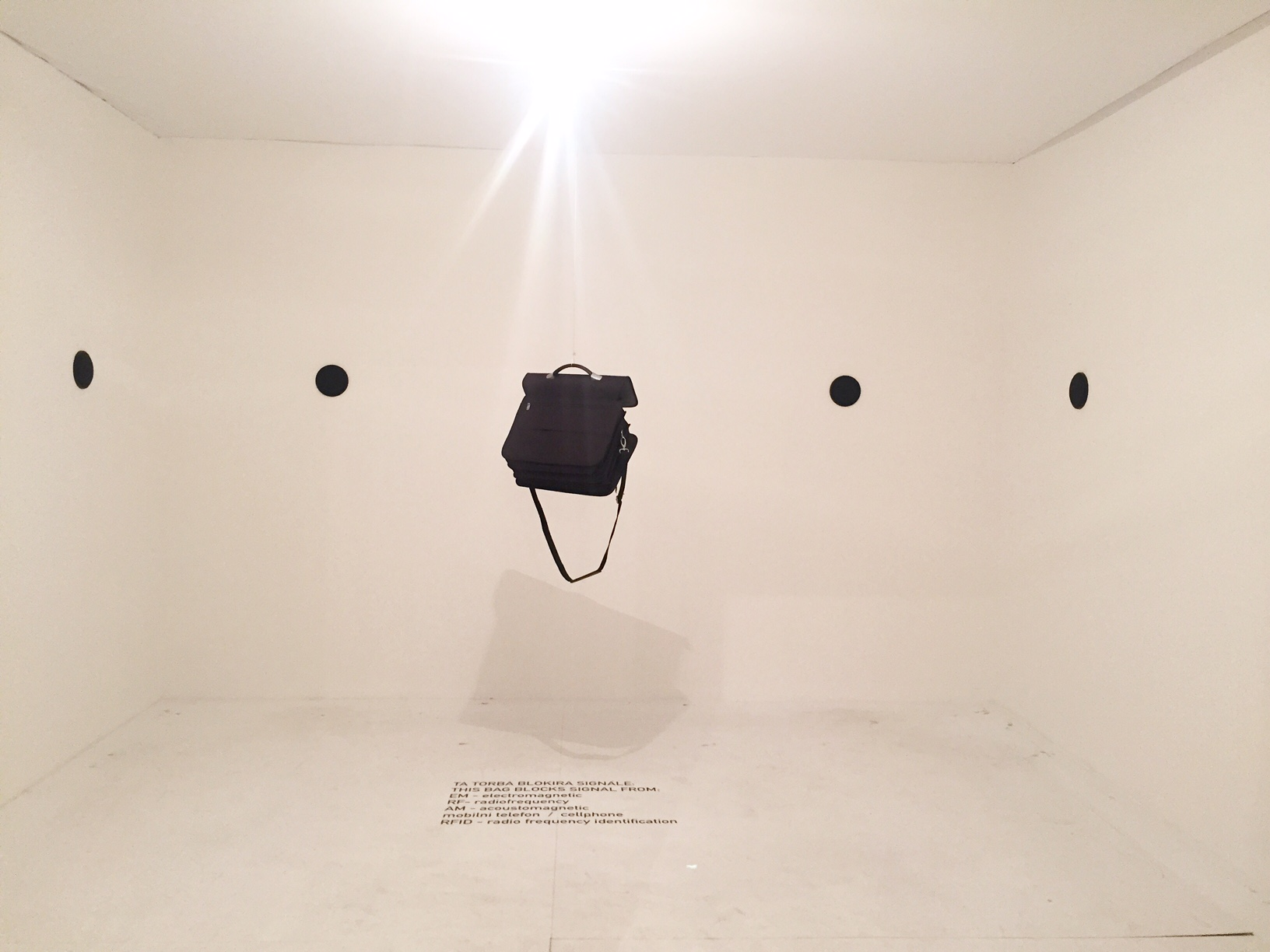 Why is there a messenger bag hanging up in a room? What does it mean?