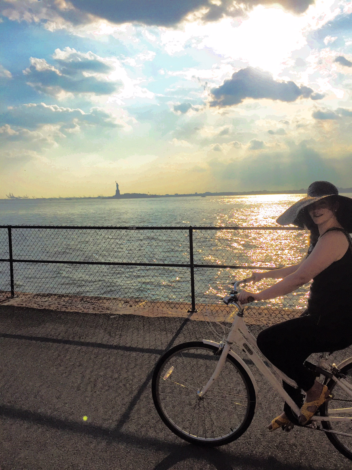 Casually cruisin' past old lady Liberty