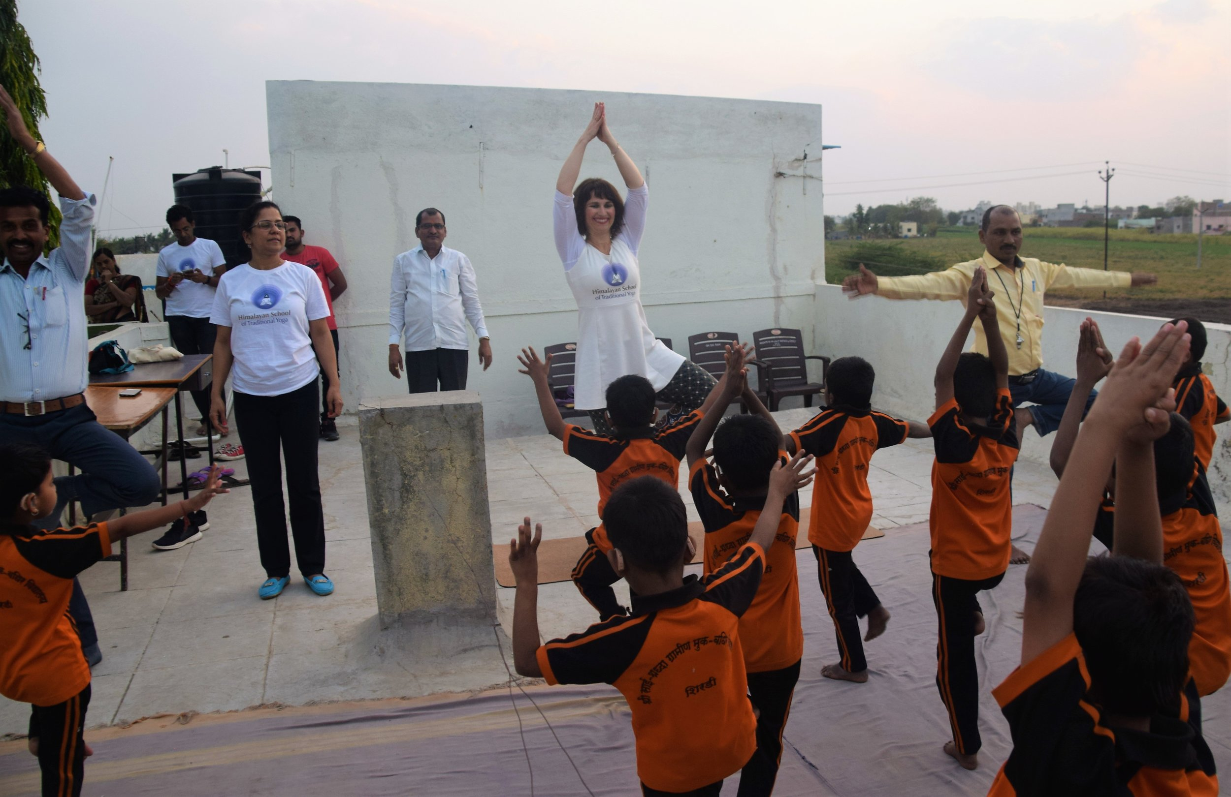 Devi leading children into Tree Pose.jpg