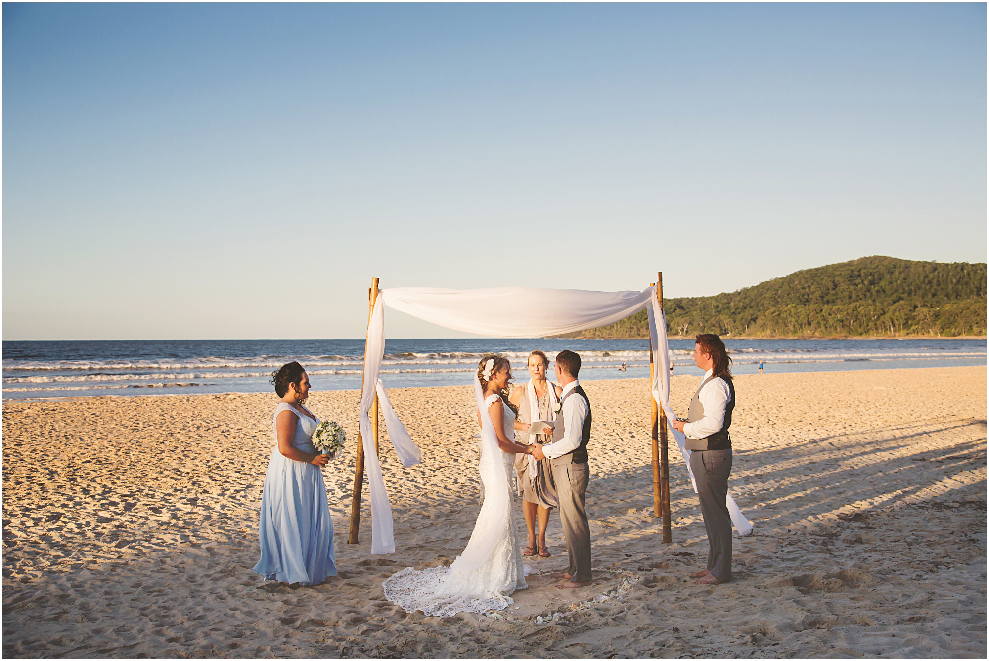 Kaela and Isaac's elopement. ceremony: Beach access 12, Noosa Heads. photography: images by Lou O'Brien. Noosa Elopements.