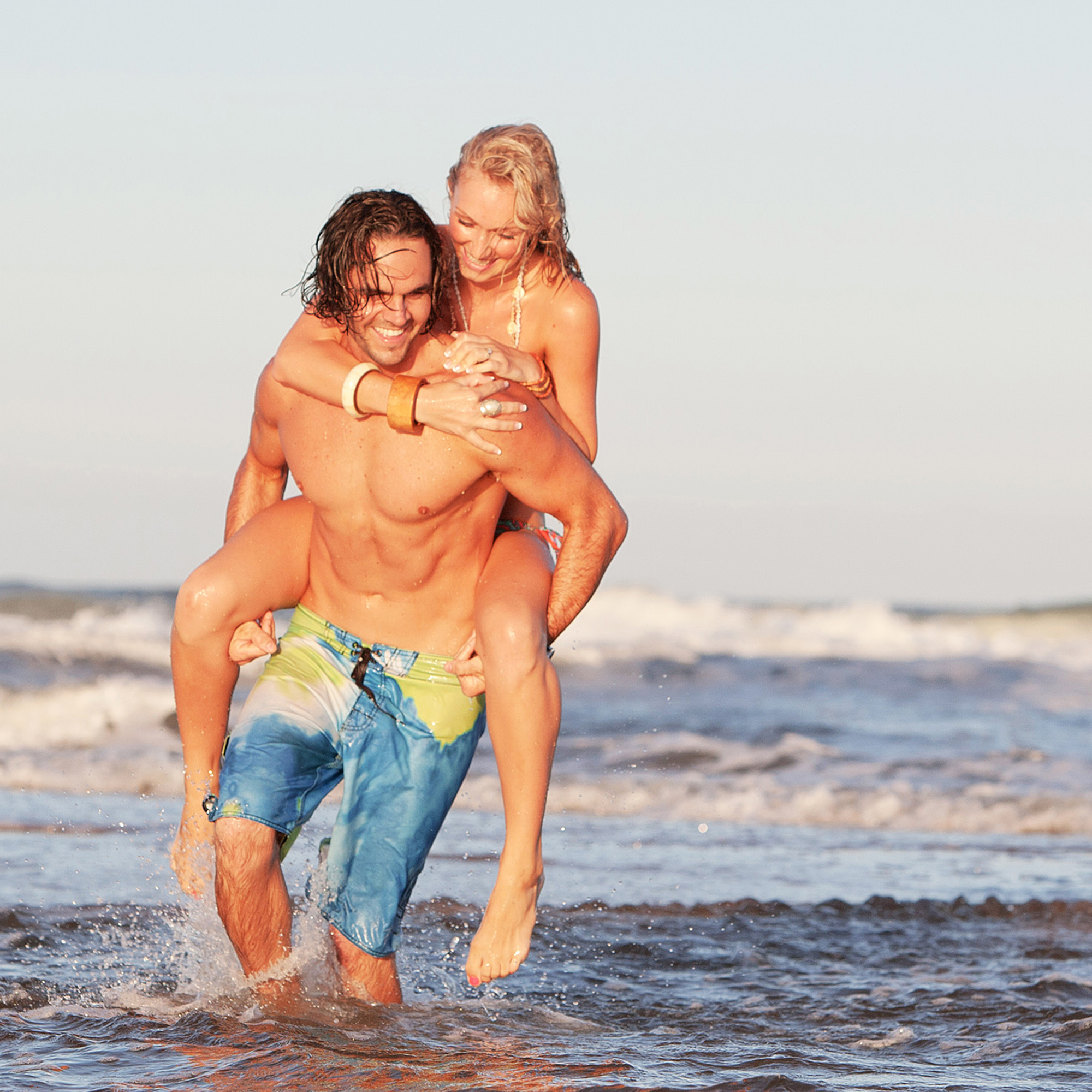 fun beach engagement photos