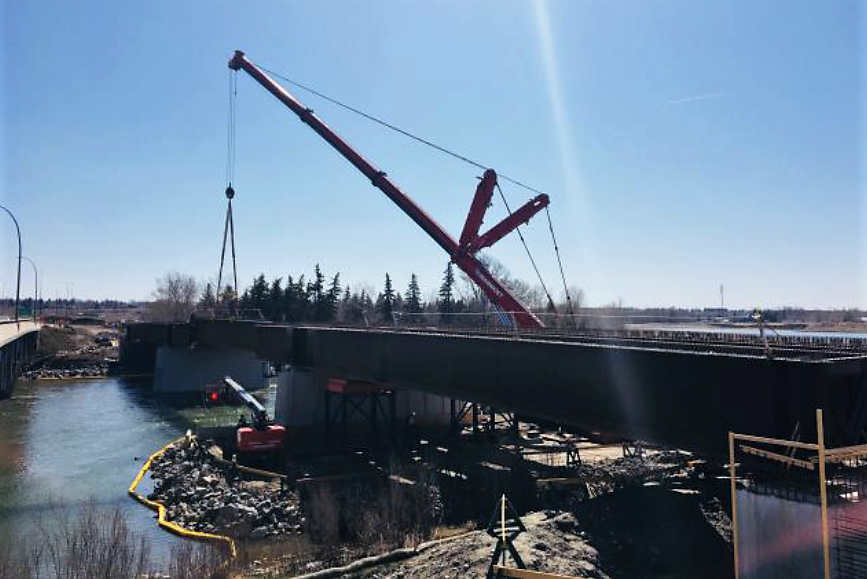 The girders have been installed and the new bridge spanning the Western Headworks Canal and Deerfoot Trail are taking shape! (Source: 17 Avenue SE BRT team)