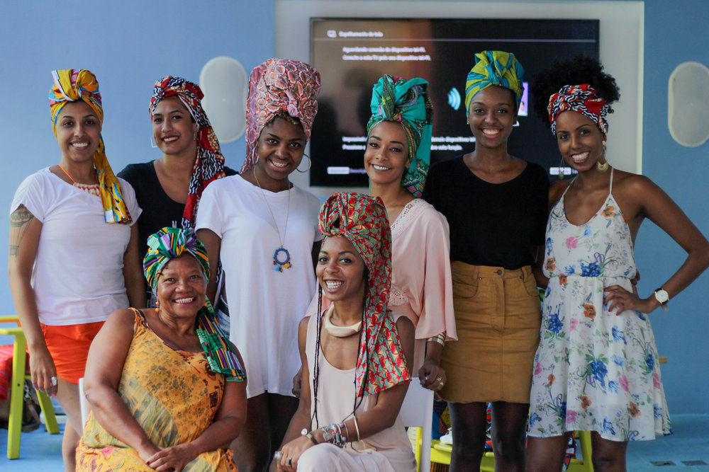 Workshops - This workshop starts with a lecture where Thaís Muniz explores the complex history of the turbans and head wraps in the Afro-Atlantic diaspora from ancient to contemporary times. With scarves in hand, investing in the practical method of DIY, the classes learn various method of wrapping and binding turbans