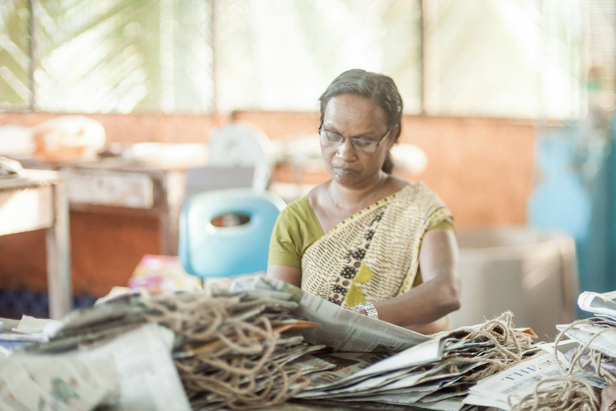 A local woman making recycled fair-trade bags. One of the many social employment programs that SISP has successfully implemented.
