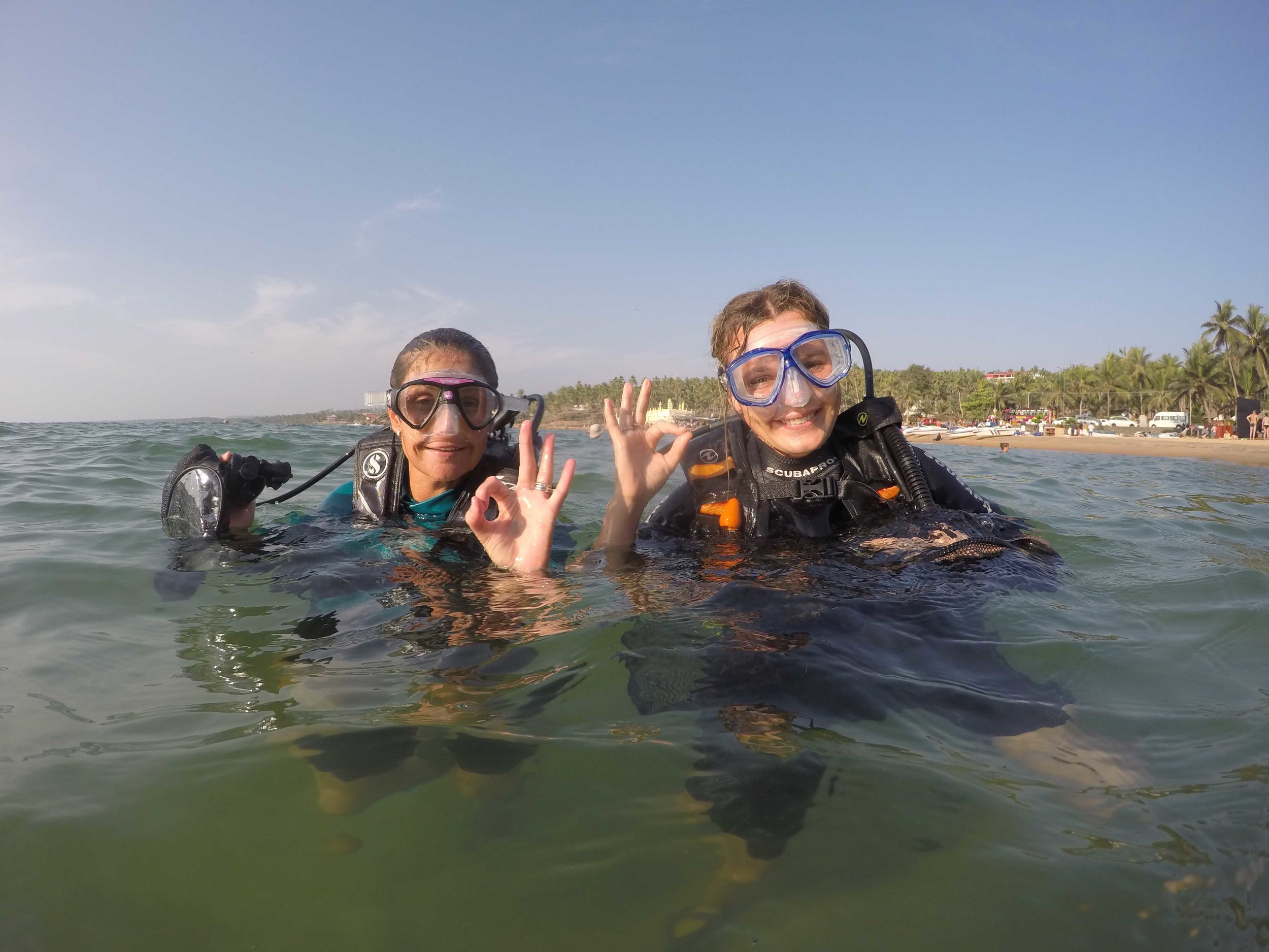 Sarah (left) and I assisting with an underwater clean-up, alongside our partners Bond Safari.
