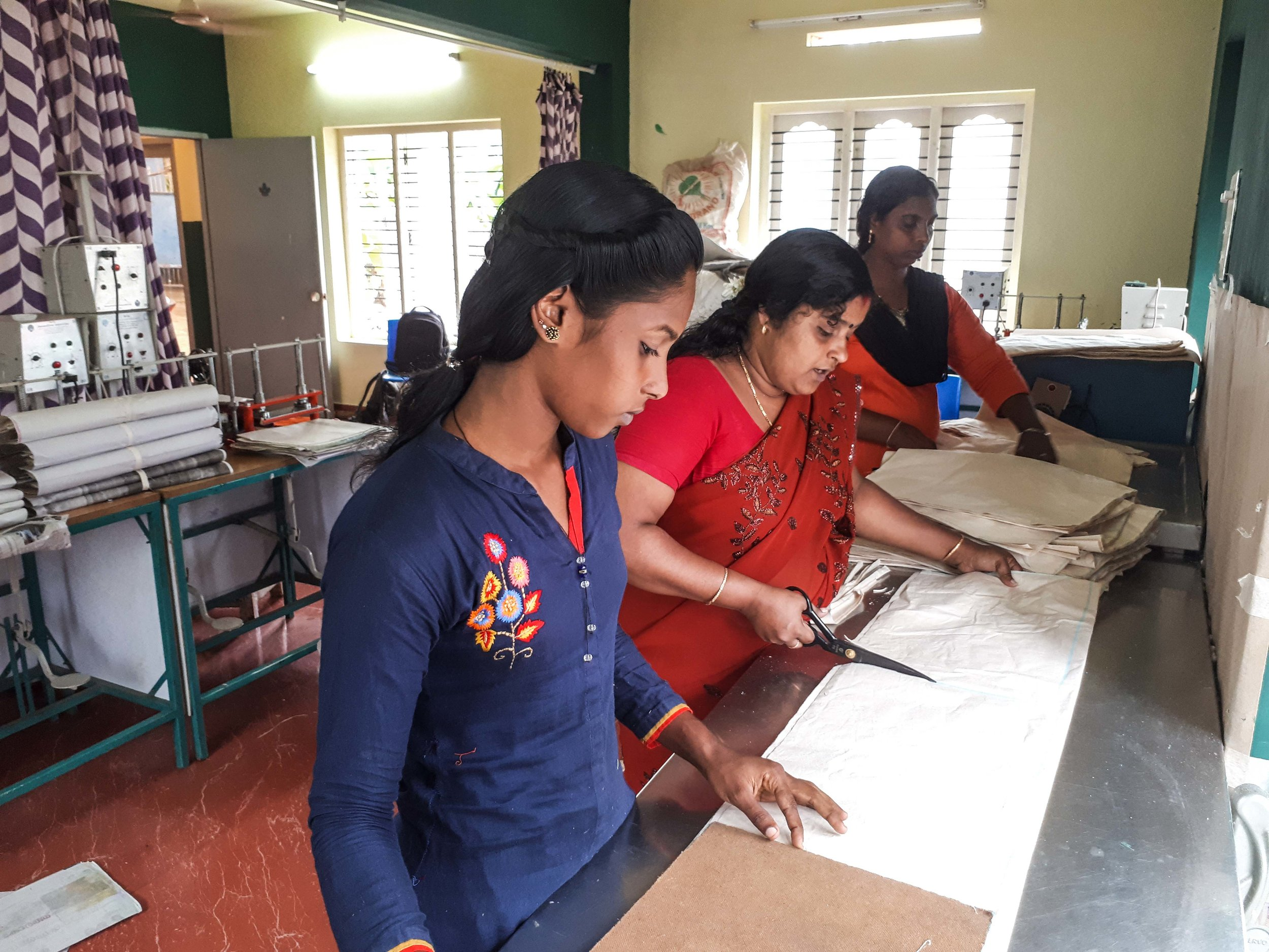 The women of SISP preparing the printing press for our bags.