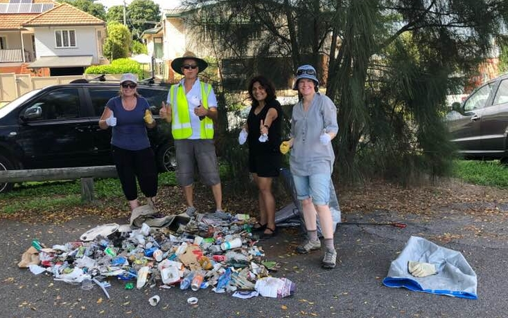 Carolyn and the local community crew collecting trash on their daily walks.
