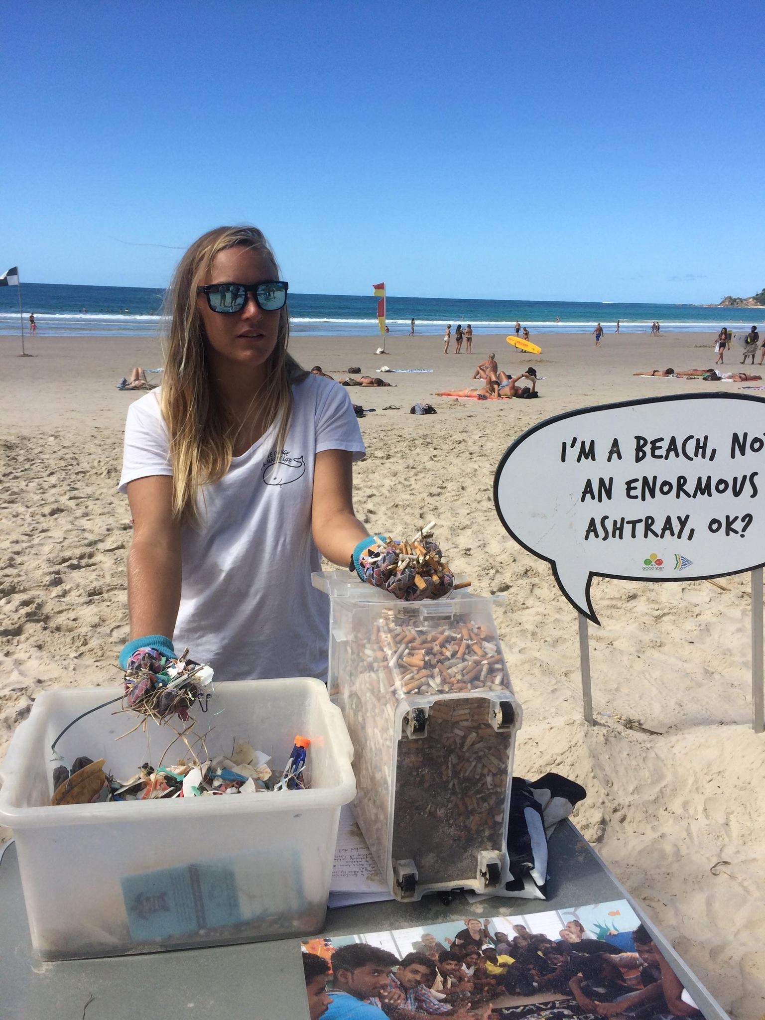 Our Byron Bay Coordinator Zoe during a film shoot shows just how many butts we collect in only a month of surveys at Main Beach!