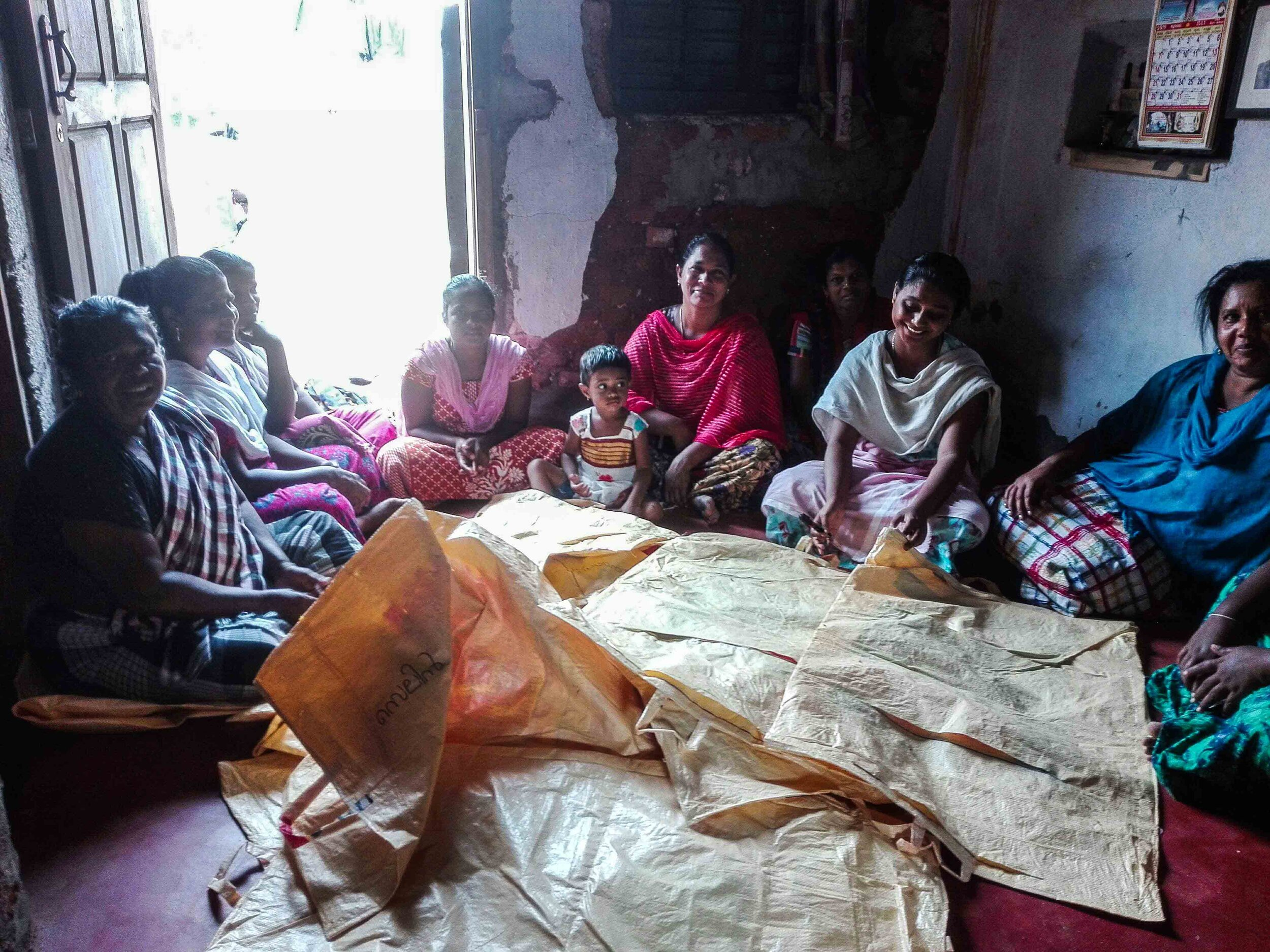 Local women sewing some of the multi-stream waste bags.